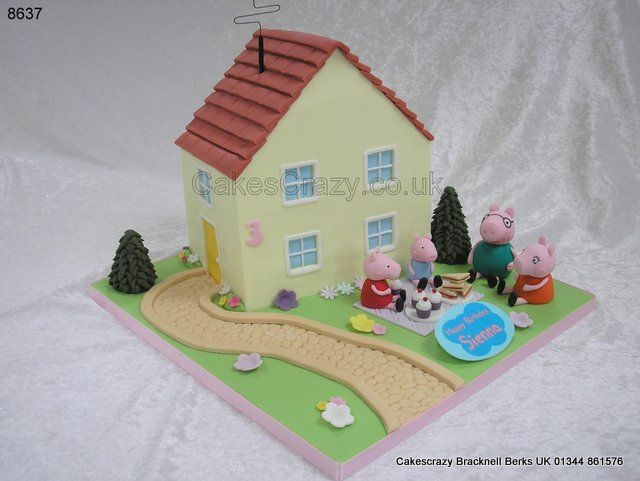 Come join the picnic... Peppa Pig house shaped cake complete with garden and path with Peppa Pig, George, Mummy and Daddy enjoying a picnic in the front garden