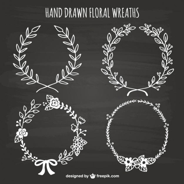 hand-drawn-floral-wreaths-on-blackboard_23-2147521725.jpg