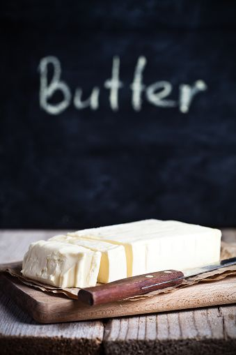 fresh butter and blackboard on rustic wooden table
